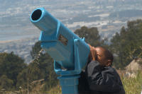 Child looking at the eclipse through telescope