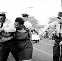 Police arresting a black woman. Photographer unknown