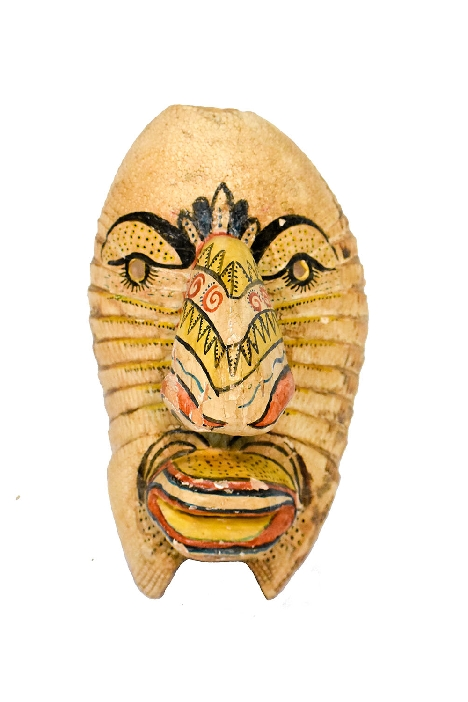 Painted armadillo shell and wood mask from Michoacán, Mexico.