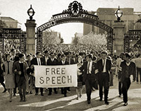 Free Speech Movement protestors walk through Sather Gate