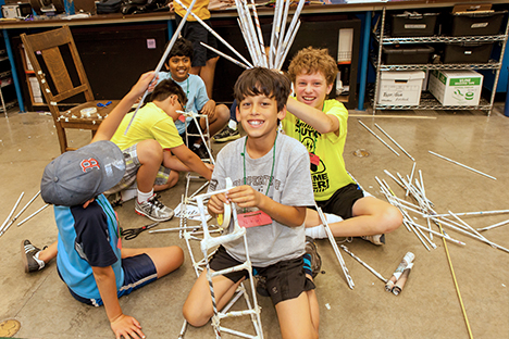 Children building structures out of paper dowels at the Lawrence Hall of Science.