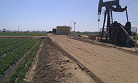 Oil well next to farmland