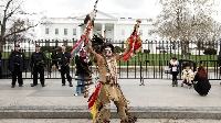 Little Thunder, a traditional Lakota dancer and indigenous activist, protests outside the White House