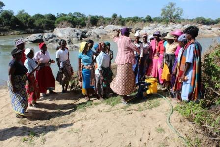 Women working with water pump